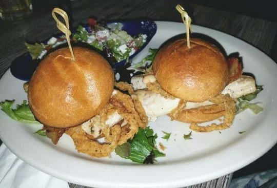 Mulligan's mahi sliders with thick mahi fillets topped with mixed greens, fried onion strings, crispy bacon and remoulade sauce. Mulligan's shows it's love for kids by offering video games, cartoons on the TVs, arcade games, toys, balloons and coloring books with crayons.
