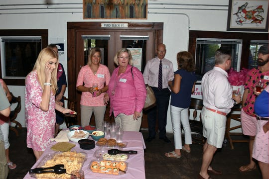 """In its third year in Vero Beach, 16 men will unite to fight breast cancer with the American Cancer Society through participation in the Real Men Wear Pink campaign. Several of these """"Real Men"""" gathered at Walking Tree Brewery recently for a meet andgreet."""