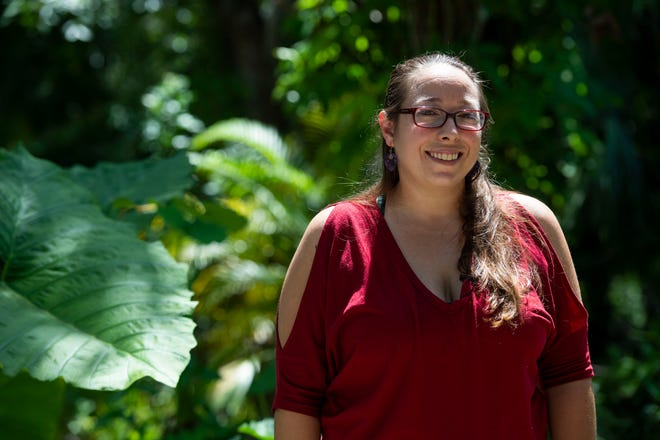"""Courtney Crowley, 33, of Fort Myers, seen Aug. 16, 2018, was displaced from her property after Hurricane Irma flooded her home, but recently moved back in with her husband, three dogs and a cat. Despite losing most of their material possessions, including her expansive book collection and her husband's music equipment, she's grateful for their safety and for having family nearby to take them in as they waited for FEMA, the insurance inspector and the claims adjuster. """"I don't ever want to give the impression that I lost everything -- because I didn't. I mean I have my husband and my animals, and that's what's really important,"""" Crowley said."""