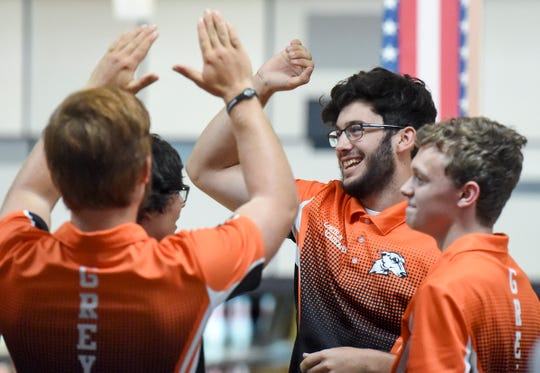 Lincoln Park Academy senior David McDaniel celebrates with his teammates Wednesday, Aug. 22, 2018, during their high school bowling match against Okeechobee at Saint Lucie Lanes in Port St. Lucie. To see more photos, go to TCPalm.com.