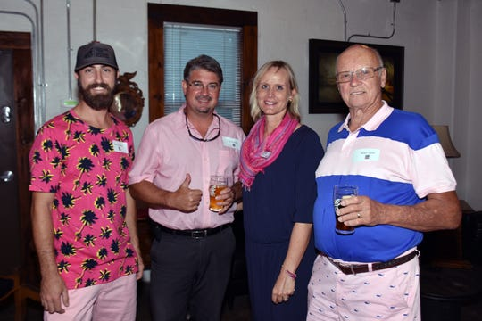 Alan Dritenbas, left, Dr. Nicholas Rutledge, Making Strides Against Breast Cancer Event Chair Laura McGarry and Ralph Carter at Walking Tree Brewery recently for a meet and greet.