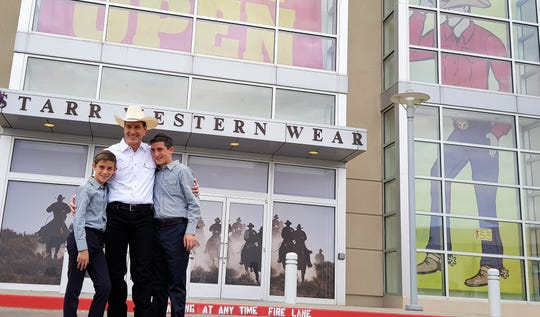 Enoch Kimmelman, owner of Starr Western Wear, stands outside Starr's new Sunland Park Mall store at an Aug. 9 grand opening celebration along with his sons, Yaakov Kimmelman, left, and Chaim Meir Kimmelman.