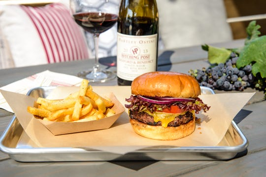 Pinot noir goes with burgers and triple-fried French fries at the new Hitching Post Wines tasting room and picnic grounds in Buellton.