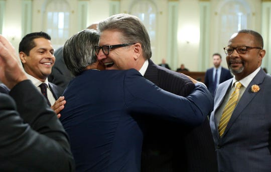 Assemblyman Rob Bonta, D-Alameda, left, and Sen. Bob Hertzberg, D-Van Nuys celebrate after the bill they co-authored to end money bail was approved was approved by the California Assembly on Monday in Sacramento. The bill was then approved by the Senate and sent to Gov. Jerry Brown for his signature.