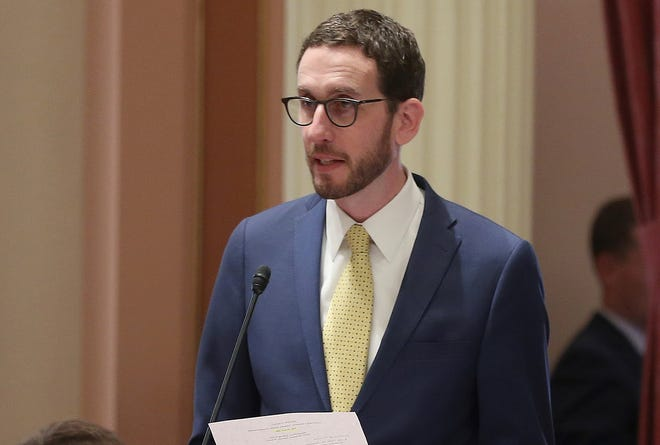State Sen. Scott Wiener, D-San Francisco, urges lawmakers to approve a bill requiring California prosecutors to erase or reduce thousands of marijuana criminal convictions Wednesday in Sacramento. The Senate approved the measure by Assemblyman Rob Bonta, D-Alameda, and sent it to Gov. Jerry Brown.