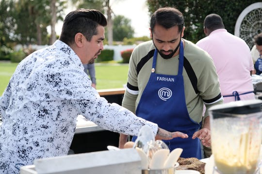 """MasterChef"" judge and celebrity chef Aaron Sanchez, left, confers with contestant Farhan Momin during an episode shot in Somis in Ventura County. ""They are finding their voice and they are valuing and using the knowledge gained from the individual mentorship that has been new this season,"" Sanchez says of the show's competitors."