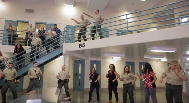 """Ventura County sheriff's deputies and staff at the county jail get down to the Bee Gee's hit """"Stayin' Alive"""" in the lip-sync challenge video."""