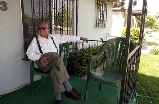 Manuel Hernandez, 90 at the time, relaxes on his front porch of his North Visalia home in 2004. He died a year later.