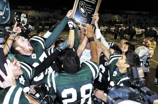 El Diamante players celebrate a 63-14 victory over Tulare Union to capture the Division 2 Valley title.