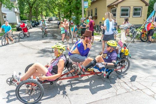 Georgia Kaftan and Philip Van Valkenberg participate in the 2017 Fat Tire Tour of Milwaukee on their recumbent trike. Van Valkenberg originated the ride, and new organizer, Jason Manders, speaks with him.