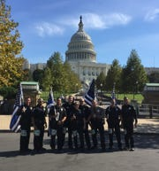 Members of the Run to Remember LA Uniform Team stop for a photo in front of the U.S. Capitol in Washington, D.C.