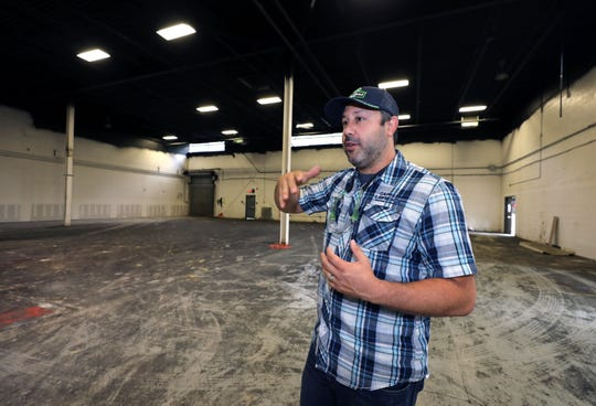 Scott Vaccaro, the founder of the Captain Lawrence Brewing Co. in Elmsford, stands in a space adjacent to the existing property, Aug. 22, 2018. They will be expanding with this move for a larger restaurant and tasting room space.
