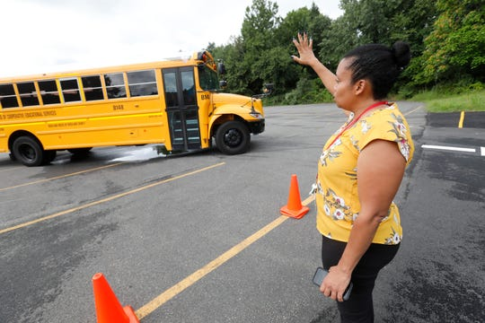 JoAnne Thompson, assistant director for school transportation, Rockland BOCES and Jayson Ramos of Suffern, practice bus driving techniques at the BOCES campus in West Nyack on Aug. 22, 2018.