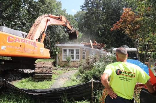 A group of residents in Pocantico Hills tried to preserve the 43 Willard Ave. home, which is one of the six-house cluster development commissioned by John D. Rockefeller in the 1930s. Despite the effort, the house was demolished Aug. 22, 2018, to make way for a new house.