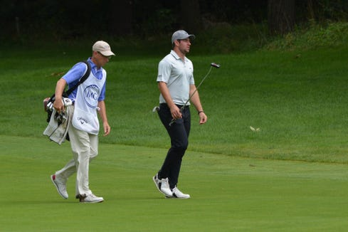 Cameron Young walks the fairway with his father and caddie, Sleepy Hollow C.C. head professional David Young.