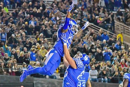 Kentucky Wildcats running back Sihiem King (22) reacts after scoring a touchdown against the Vanderbilt Commodores during the second half at Vanderbilt Stadium.