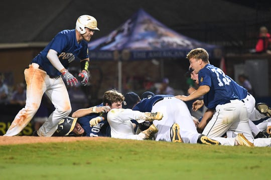 Delaware Post One players celebrate after defeating Las Vegas Post 40 1-0 in the championship game of the American Legion World Series on Tuesday night in Shelby, N.C.