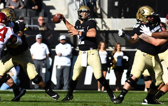 Colorado Buffaloes quarterback Steven Montez (12) prepares to pass the ball in the first half against the USC Trojans at Folsom Field.