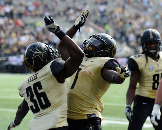 Vanderbilt Commodores wide receiver Trey Ellis (36) celebrates with running back Ralph Webb (7) after a touchdown during the first half against the WKU Hilltoppers at Vanderbilt Stadium.