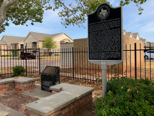 A historical commission marker and memorial bench marks the site of the former Booker T. Washington High School - a historically African-American school. The last remaining buildings of the school were demolished to create an income-based apartment complex called Washington Village.