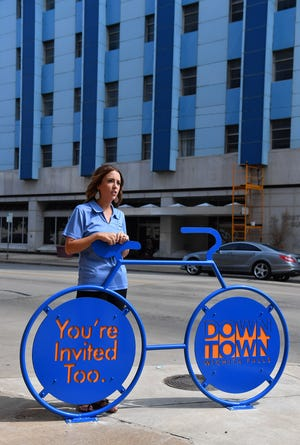 Jana Schmader, executive director of Downtown Wichita Falls Development, talks about the first of four new sculptural bicycle racks being installed downtown.