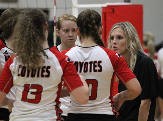 Wichita Falls High School head volleyball coach Dakota Crockett talks to her players during a changeover in the match against Christ Academy Tuesday, Aug. 21, 2018, in the WFHS gym.