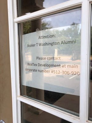 A sign on the door of the Booker T. Washington High School Alumni and Support Services Center is seen in August. The sign went up in June and the locks were changed, preventing the association from accessing their property.