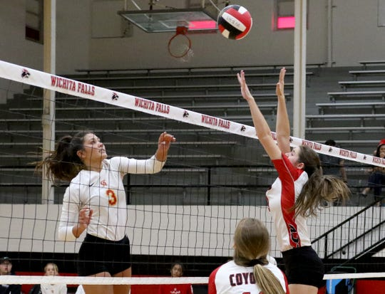 Christ Academy's Kelsey McClellan hits the ball over the reach of Wichita Falls High School's Raylee Darden Tuesday, Aug. 21, 2018, in the WFHS gym.