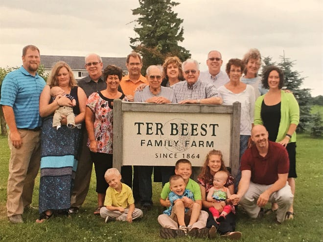 Dayton and his brother, David (center) are surrounded by family on the TerBeest family farm that was established 154 years ago by the TerBeest brother's great grandparents who emigrated to American from the Netherlands in the early 1860s.