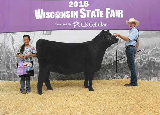 S&R Emma J721 won reserve grand champion owned female at the 2018 Wisconsin State Fair Junior Angus Show, Aug. 7 in West Allis, Wis. Samuel Henderson, East Troy, Wis., owns the March 2017 daughter of Vision Unanimous 1418. She first won reserve junior champion.