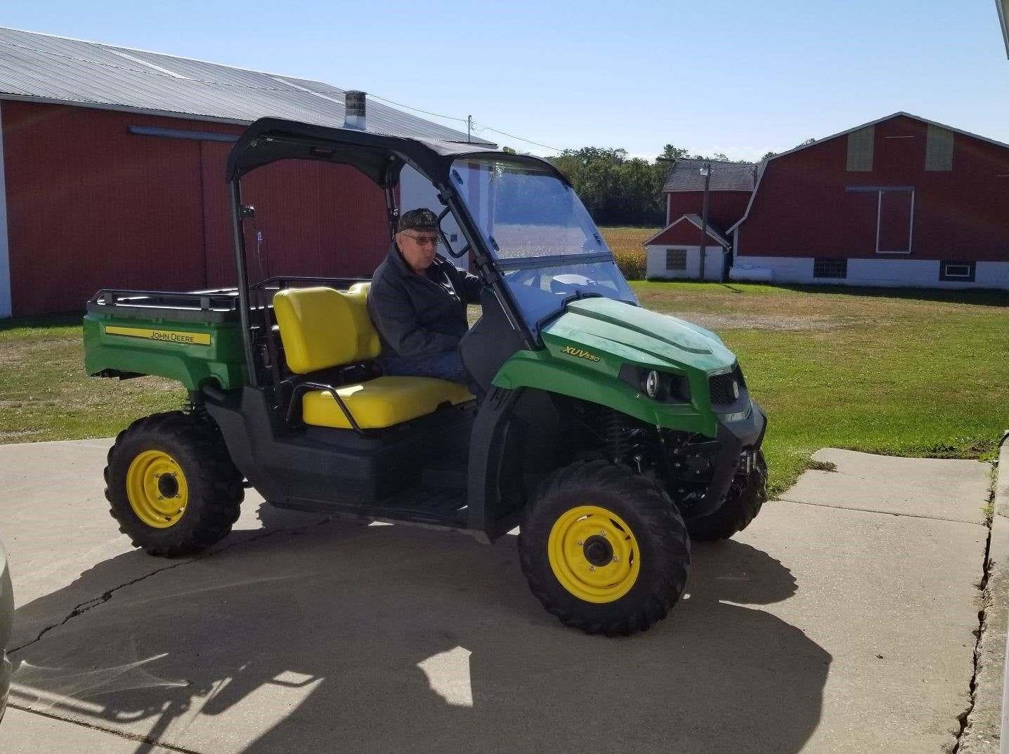 Dayton's Gator helps him get around on the farm nowadays.