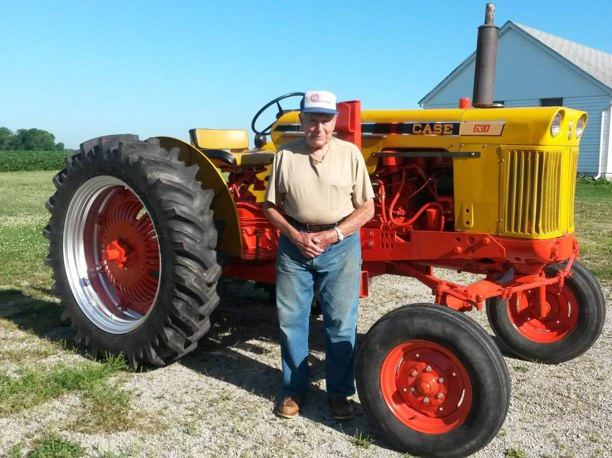 Neighbor Lee Ellens helped paint Dayton TerBeest's Case 630 tractor, which he purchased new in the early 1960s.