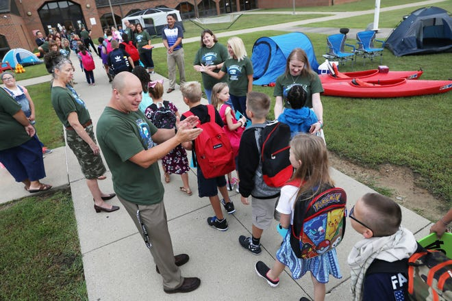 Students at National Road Elementary School were welcomed back with a happy camper themed display outside the school.