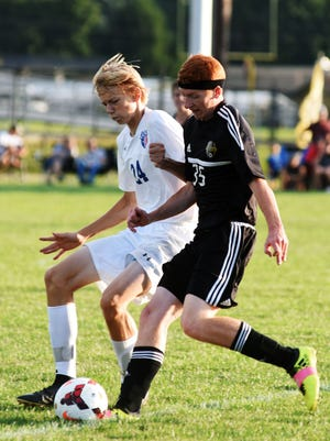 Zanesville's Leyton Needles, left, fights for possession against River View's Owen Glazier during their match on Tuesday in Warsaw. The Black Bears won, 3-0.