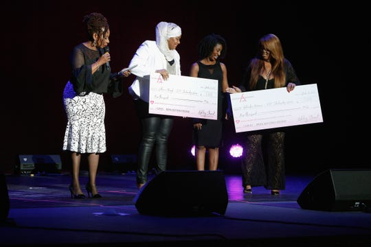 Iyanla Vanzant presents Latchmie Marajh and Kedeisha Freeman with the Medgar Evers Scholarship award onstage at Finding Ashley Stewart 2017 at Kings Theatre on Sept. 16, 2017, in New York.