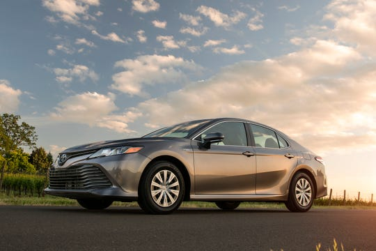 This undated photo provided by Toyota shows the 2018 Camry Hybrid. The vehicles standard equipment  includes heated seats, LED headlights, and advanced safety features such as adaptive cruise control and lane departure warning. (David Dewhurst Photography/Courtesy of Toyota Motor Sales via AP)