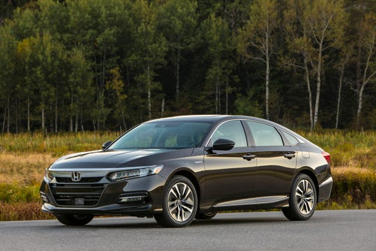 This photo provided by Honda shows the 2018 Honda Accord Hybrid. The vehicle offers new changes for 2018, such as improved trunk space and a folding rear seat. (Courtesy of American Honda Motor Co. via AP)