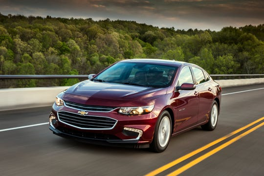 This undated photo provided by General Motors shows the 2018 Chevrolet Malibu Hybrid. The vehicle offers noise-reducing side windows, Apple CarPlay and in-car Wi-Fi. (Courtesy of General Motors via AP)