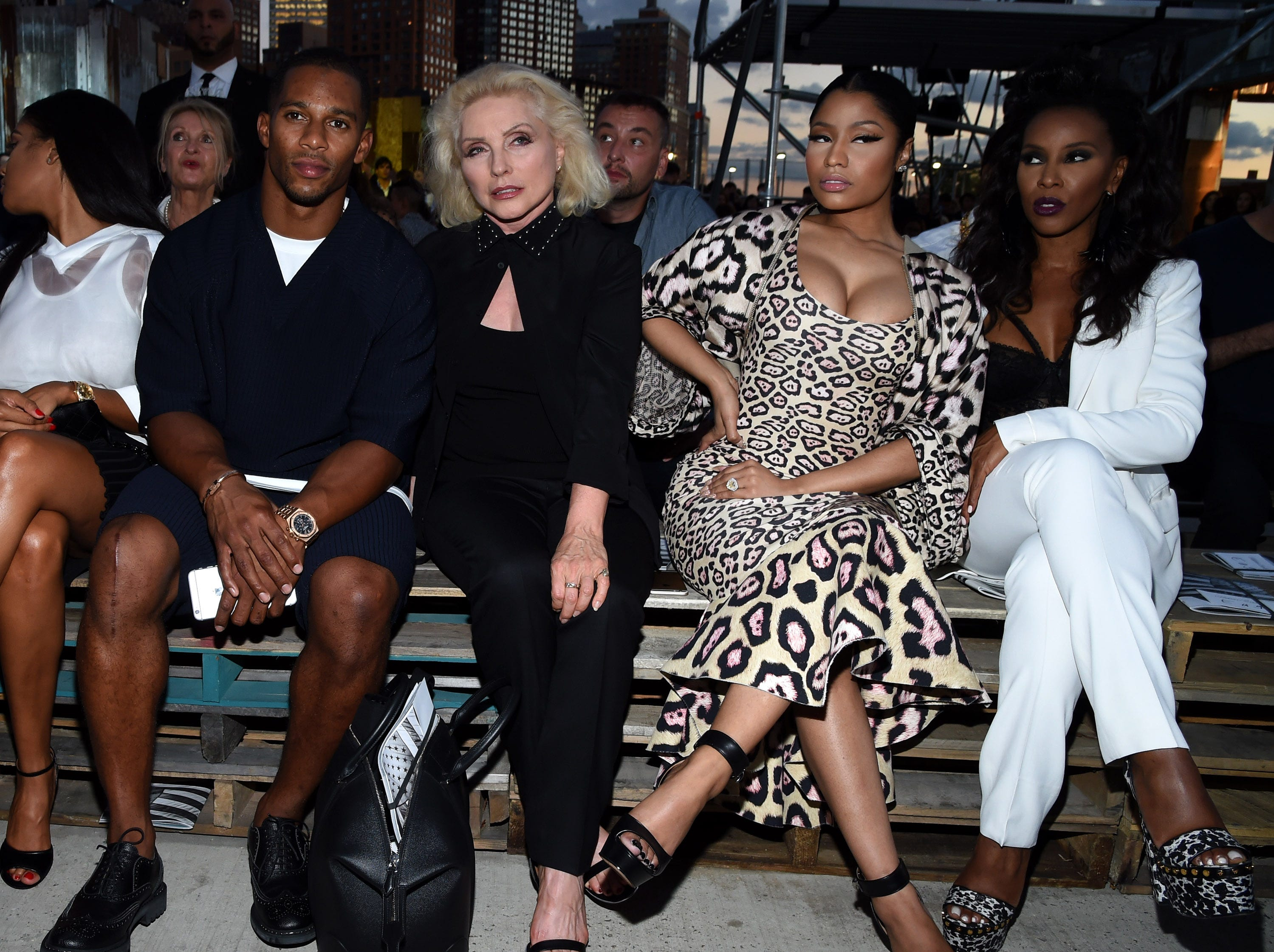 NEW YORK, NY - SEPTEMBER 11:  (L-R) Victor Cruz, Debbie Harry, Nicki Minaj and June Ambrose attend the Givenchy fashion show during Spring 2016 New York Fashion Week at Pier 26 at Hudson River Park on September 11, 2015 in New York City.  (Photo by Larry Busacca/Getty Images) ORG XMIT: 575593401 ORIG FILE ID: 487807220