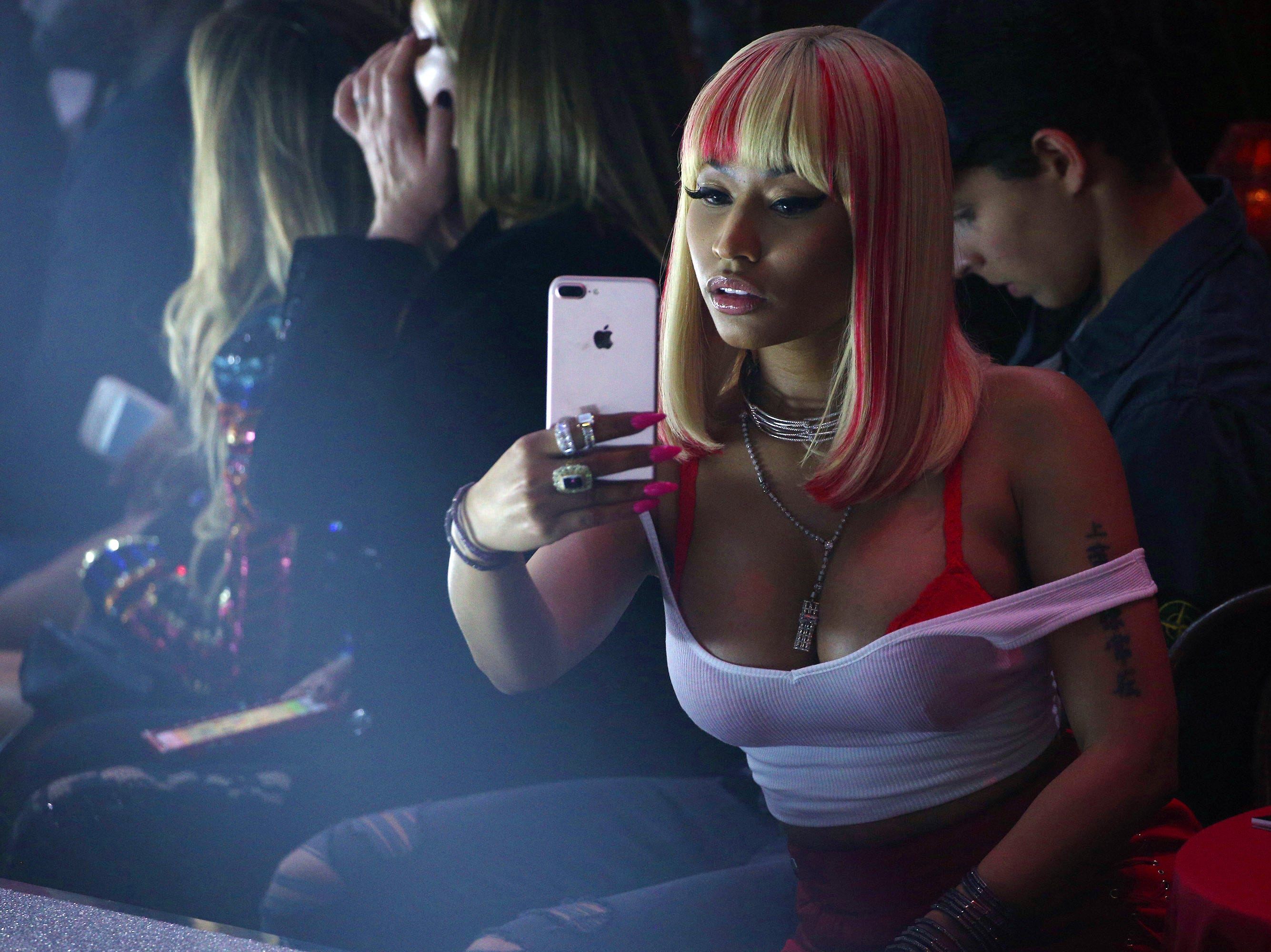 NEW YORK, NY - SEPTEMBER 09:  Nicki Minaj takes selphies for social media at the Philipp Plein Spring/Summer 2018 collection fashion show during New York fashion week on September 9, 2017 in New York City.  (Photo by Edward James/WireImage) ORG XMIT: 775032989 ORIG FILE ID: 845140558