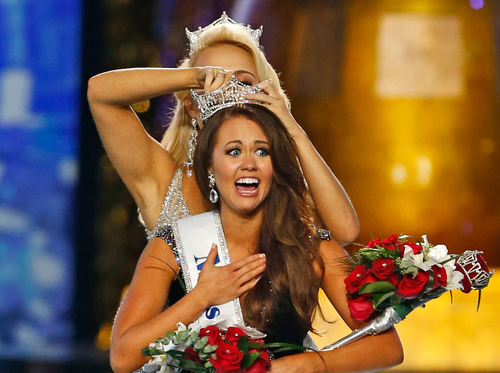 FILE – In this Sept. 10, 2017, file photo, Miss North Dakota Cara Mund reacts after being named Miss America during the Miss America 2018 pageant in Atlantic City, N.J. In a letter sent to former Miss Americas on Friday, Aug. 17, 2018, Mund says she has been bullied, manipulated and silenced by the pageant's current leadership, including chairwoman Gretchen Carlson. (AP Photo/Noah K. Murray, File) ORG XMIT: NJPX201