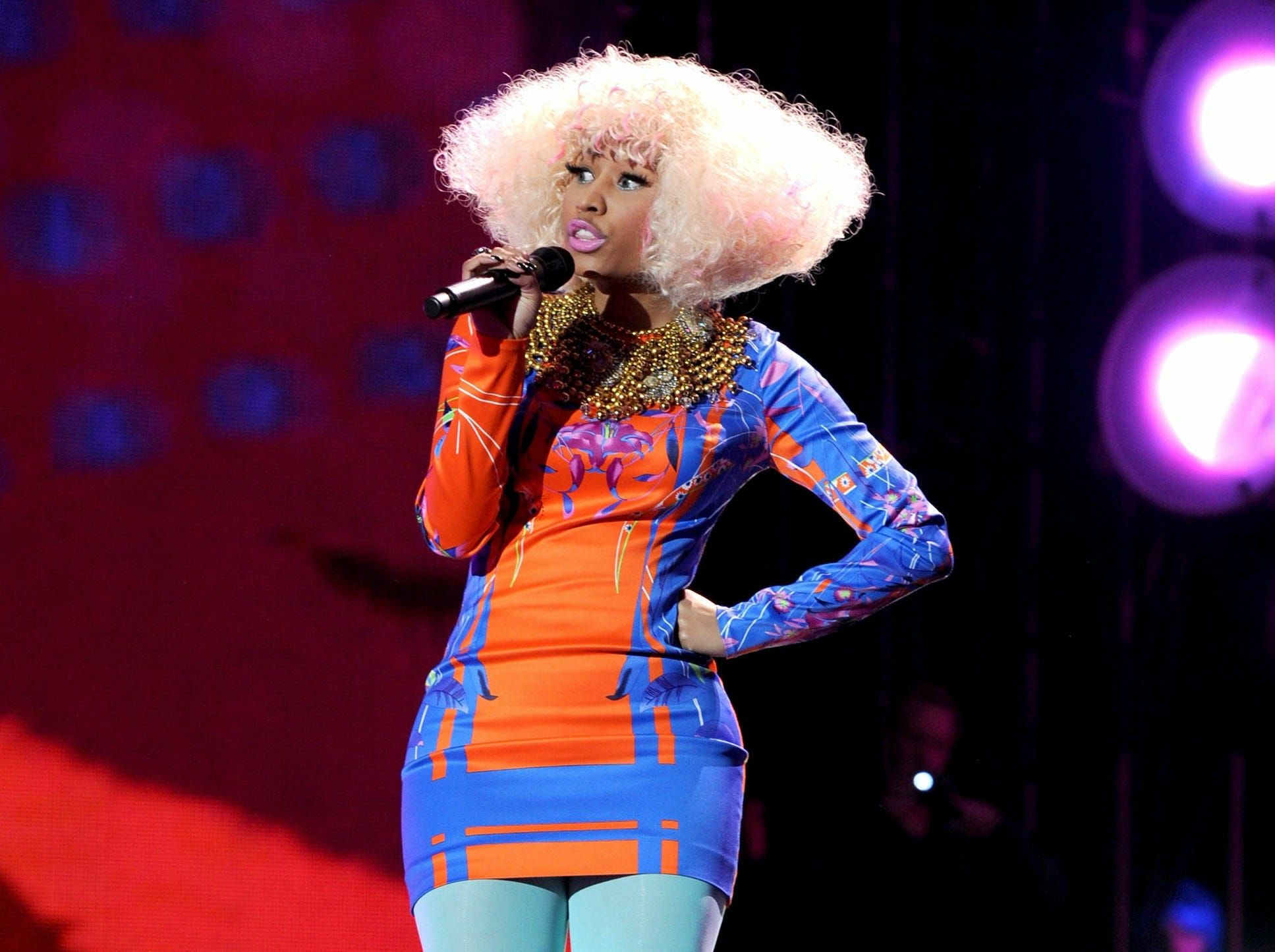 "ORG XMIT: 106786335 MIRAMAR, CA - DECEMBER 03:  Singer Nicki Minaj performs onstage during ""VH1 Divas Salute the Troops"" presented by the USO at the MCAS Miramar on December 3, 2010 in Miramar, California. ""VH1 Divas Salute the Troops"" concert event will be televised on Sunday, December 5 at 9:00 PM ET/PT on VH1.  (Photo by Kevin Winter/Getty Images for VH1) ORIG FILE ID: 106786335PB038_The_USO_Pres"