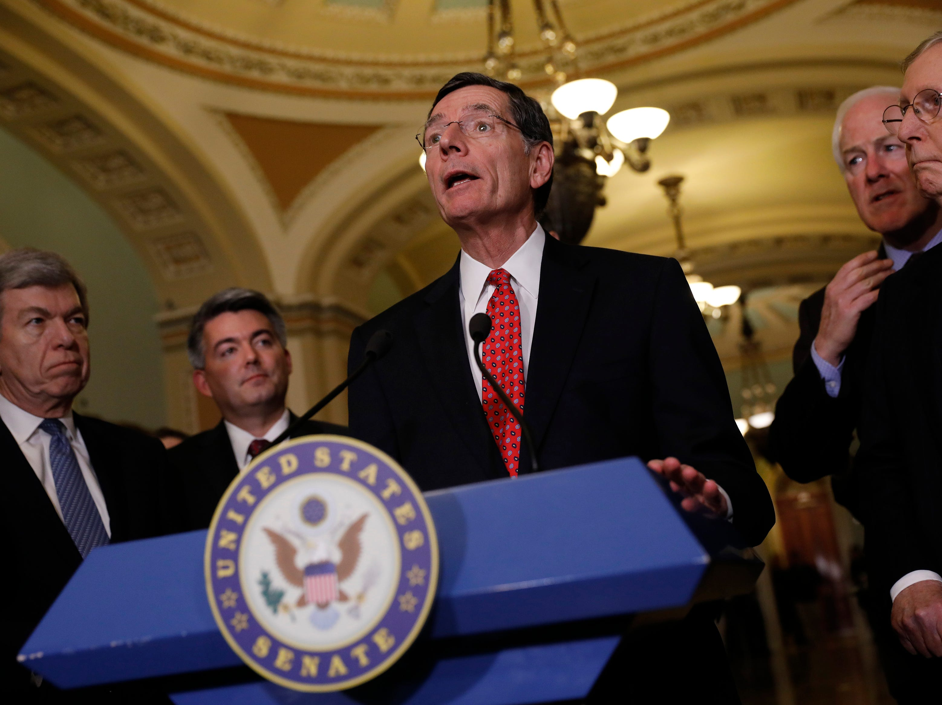 Sen. John Barrasso, center, is chairman of the Senate Committee on Environment and Public Works.
