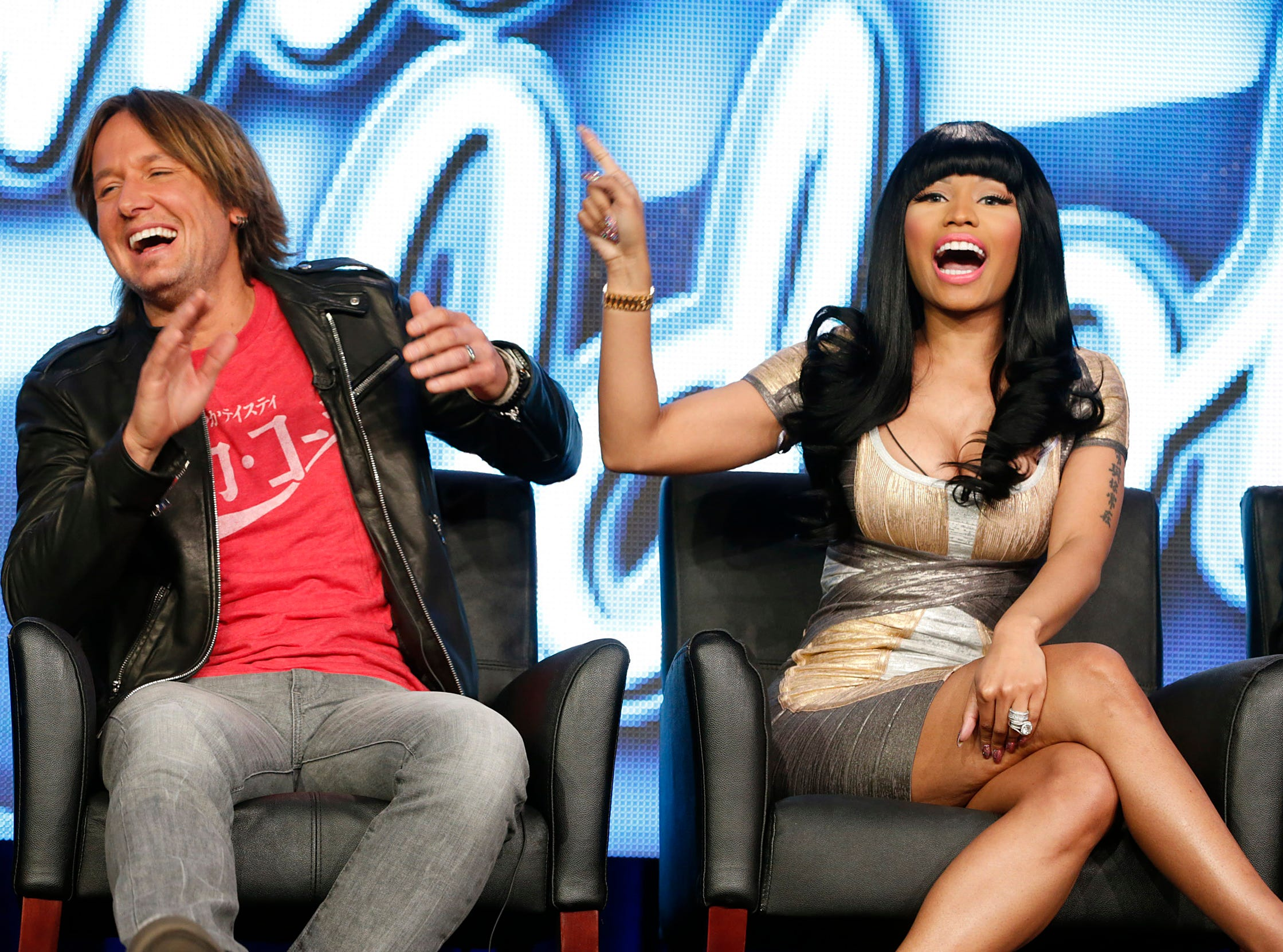 "Keith Urban, left, and Nicki Minaj from ""American Idol"" attend the Fox Winter TCA Tour at the Langham Huntington Hotel on Monday, Jan. 7, 2013, in Pasadena, Calif. (Photo by Todd Williamson/Invision/AP) ORG XMIT: NYET275"
