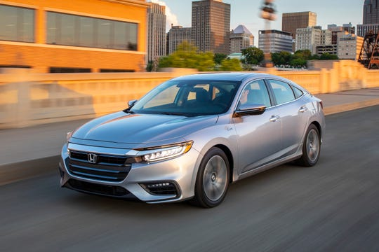 This undated photo provided by Honda shows the 2019 Honda Insight, which returns to the U.S. after a five-year absence. It now more closely resembles Honda's Civic and Accord models. (Courtesy of American Honda Motor Co. via AP)