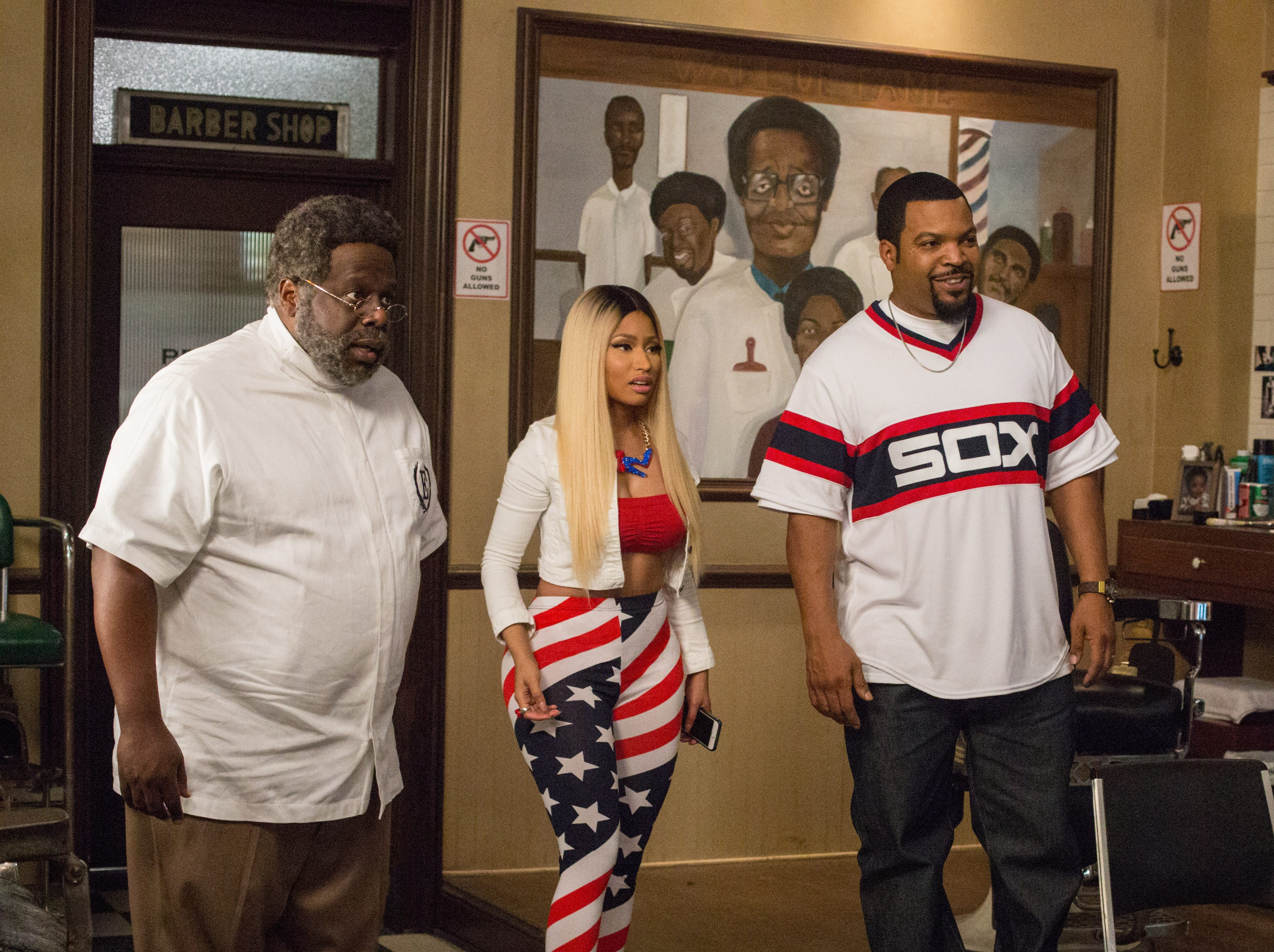"CEDRIC THE ENTERTAINER as Eddie, left, NICKI MINAJ as Draya and ICE CUBE as Calvin in a scene from the motion picture comedy ""BARBERSHOP: THE NEXT CUT, "" a Warner Bros. Pictures release.   HANDOUT Photo by Chuck Zlotnick, Warner Bros. [Via MerlinFTP Drop]"
