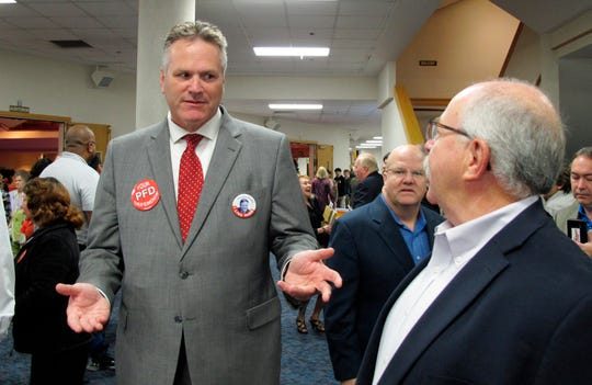 In this file photo, Mike Dunleavy, then a candidate for governor, attends a meet-and-greet event at a church in Anchorage, Alaska.