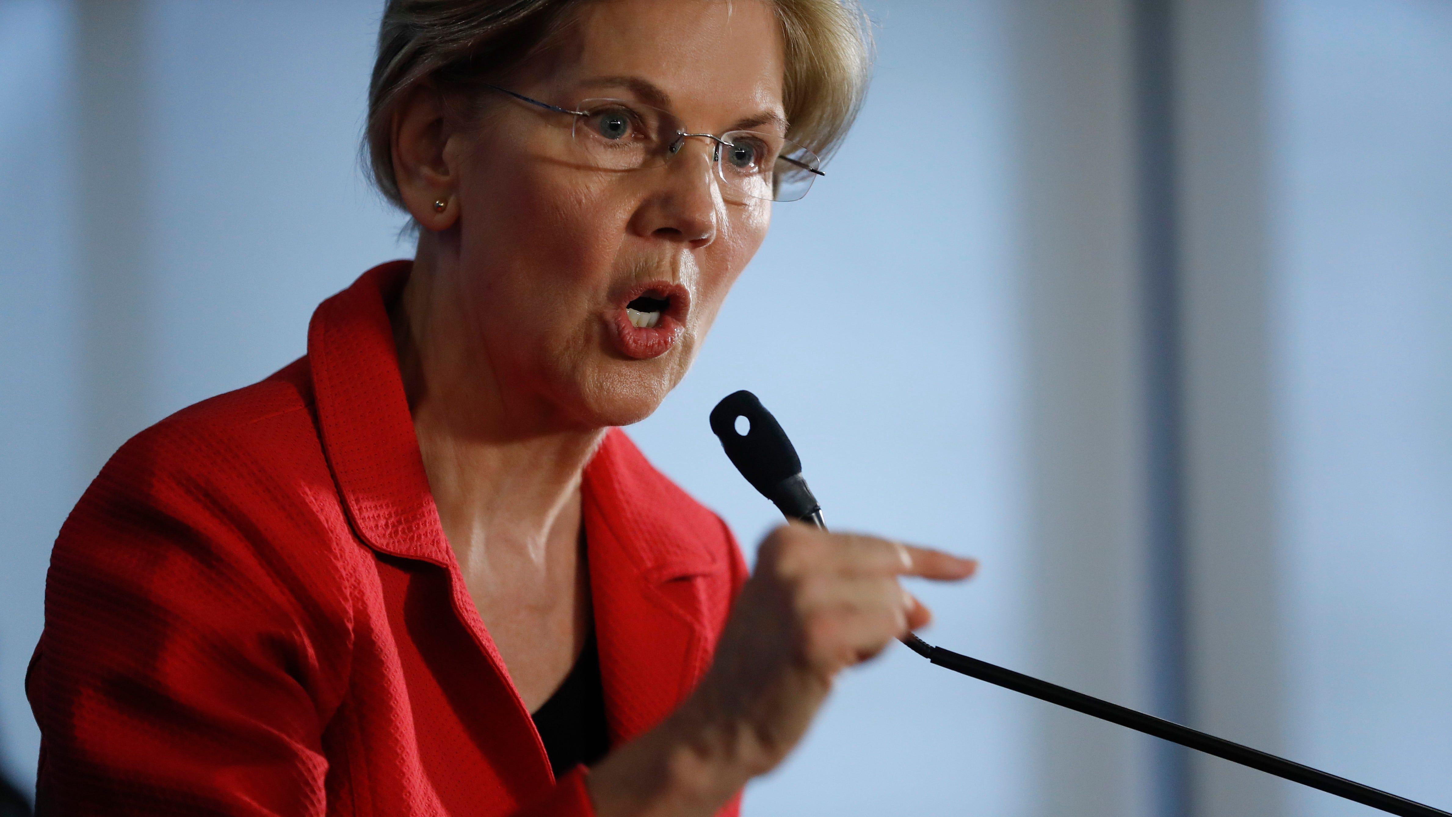 Sen. Elizabeth Warren, D-Mass., gestures while speaking at the National Press Club in Washington, on Aug. 21, 2018.