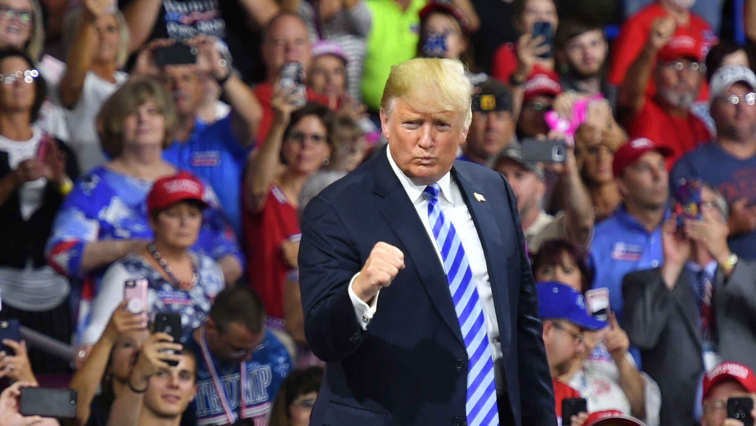President Donald Trump salutes his supporters after speaking at a political rally at Charleston Civic Center in Charleston, W.Va. Tuesday.