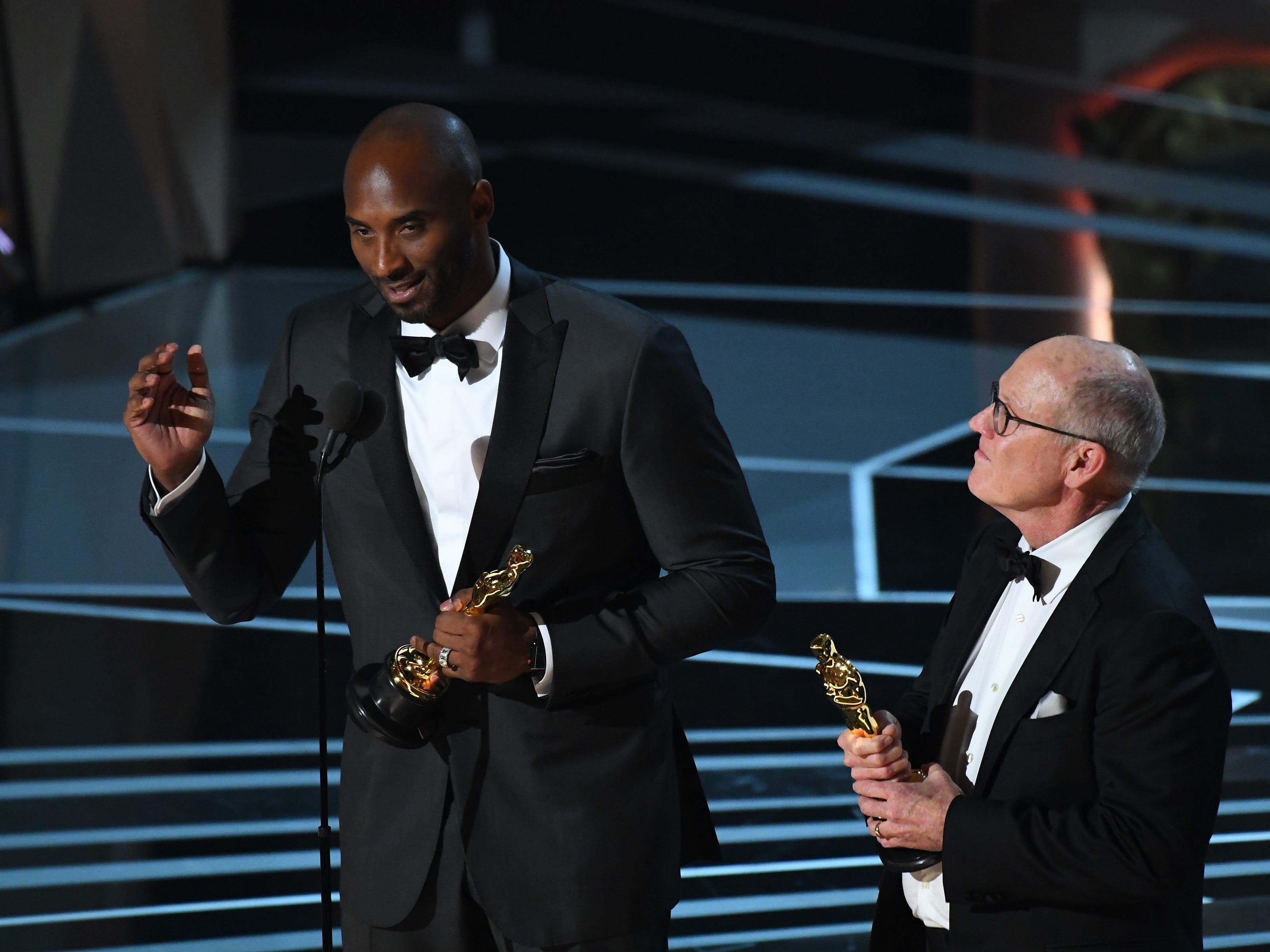 "Glen Keane and Kobe accept the Oscar for best animated short film for ""Dear Basketball."""